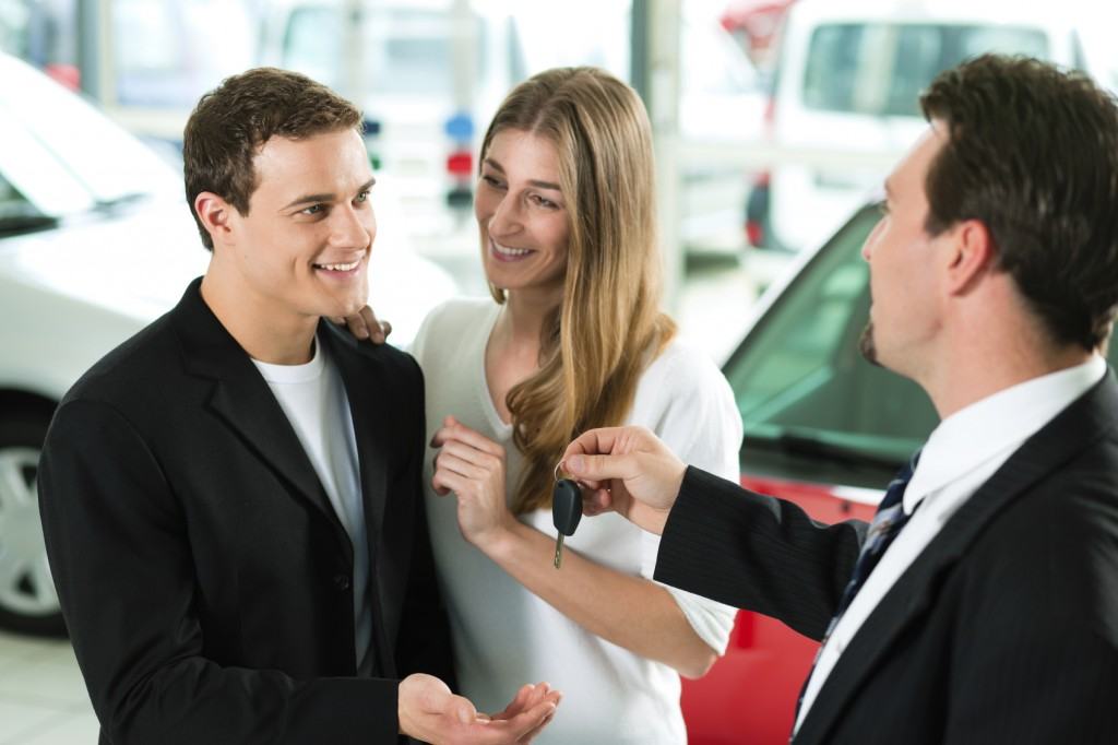 Properly Trained Salesperson Handing Over Keys